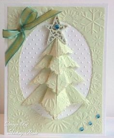 This is so incredibly beautiful! I love the colors she chose, so soft and wintery at the same time. I like her choices and embossing even better than the samples she drew from. Love it!