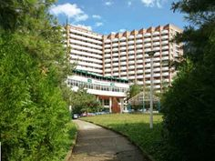 Hotel Dacia Baile Herculane este situat in parcul Vicol, langa Hotel Domogled Baile Herculane si Hotel Diana Baile Herculane si are cea mai mare capacitate de cazare din statiune, cu 15 etaje + parter, 5 lifturi, cu baza de tratament, cu o capacitate mare de tratament, restaurant si gradina de vara. Hotel Dacia Baile Herculane este un hotel clasificat la doua stele dar are camere si de trei stele. Bar Drinks, Terrace, Multi Story Building, Sidewalk, Engineering, Clouds, City, Hotels, Europe