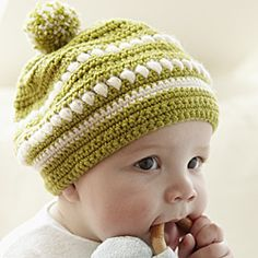 Make a crocheted pom pom hat This adorable crocheted hat is made with soft materials, such as an alpaca and merino mix, so it's not only delicate looking but gentle on your little one's sensitive skin as well.By Nicki Trench Photography by Penny Wincer Bonnet Crochet, Crochet Cap, Crochet Beanie, Love Crochet, Crochet Kids Hats, Crochet Crafts, Crochet Projects, Knitted Hats, Bandeau Crochet
