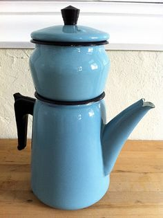 Coffee pot, there is a similar one but with a nice design here: http://www.rubylane.com/item/1269580-EBCP001/French-enamelware-coffee-pot-grey-blue