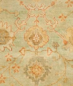 Love this rug with warm gold, coral and green