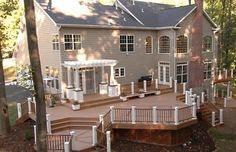 i need a deck like this on my house!! takes care of the hill leading to the flat 7 acres!!