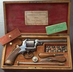 Adams & Lefaucheau pinfire revolver.  Charles Fusnot, of Bruxelles, Belgium is the manufacturer of the cartridges: http://freemycollection.com/?page=manufacturers&id=17&name=Charles-Fusnot-Fabrique-de-Balles-et-Cartouches