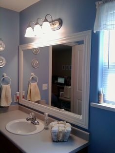This Thrifty House: Framed Bathroom Mirror---molding added to perimeter of existing mirror...