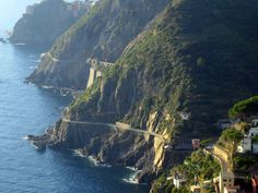 Via dell'Amore (walkway of love) in Cinque Terre, Italy that is said to cause people to fall in love as they walk down it. A walkway next to the sea in the of the cliffs of Cinque Terre that connects several cities and towns. By farrrr the coolest thing I've ever done, take me backk