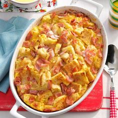Eggs Benedict Casserole Recipe -Here's a casserole as tasty as eggs Benedict, but without the hassle. Simply assemble the ingredients ahead, and bake it the next morning for an elegant breakfast or brunch. —Sandie Heindel, Liberty, Missouri