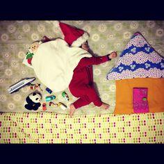 sleeping baby helping santa