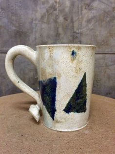 Blue Triangle Stoneware Mug with Cream Speckle Glaze by KatieTroisi on Etsy https://www.etsy.com/listing/261794118/blue-triangle-stoneware-mug-with-cream