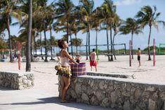 On the Beach… SoBe, Miami « The Sartorialist. Nice beachwear, lady. Even the hair and bag are awesome.