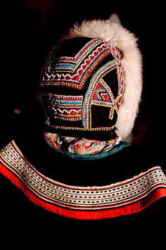 A traditional Dolgan woman's hat with ornate beadwork and fur ruff. Taymyr, Northern Siberia, Russia