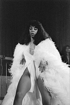 This woman was a goddess. Great legs, big hair, BIG VOICE. Donna Summer.