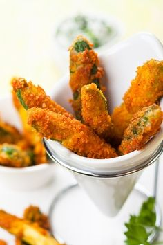 Fried zucchinis with breadcrumbs. A perfect mouthwatering appetizer.  A Mediterranean inspiration, easy to make! More interesting recipes on http://www.greek-olive-oil.com/oliveoilrecipes.html