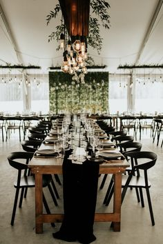 The couple decorated their wedding reception with elements that made them feel at home and hosted a family style dinner. | Image by Cannon Weddings