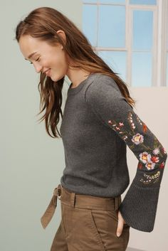 With embroidered florals and bell sleeves this sweater is the coziest
