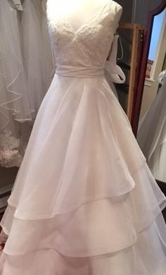 Mikaella 1584 12: buy this dress for a fraction of the salon price on PreOwnedWeddingDresses.com