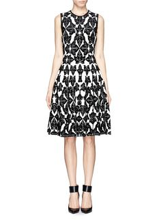 A clean-lined number free from excessive seams and embellishments, this beautifully flared dress from Alexander McQueen channels a strong graphic impact solely with a leaf jacquard in a furry texture.
