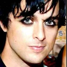 Those beautiful eyes with the smudgy eyeliner..Billie Joe Armstrong evokes mystery and melancholy, like the old time silent movie actors.
