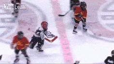 Awww... that's incredibly sweet... not exactly fair... but sweet. Nice ref helping out a peewee hockey goalie.