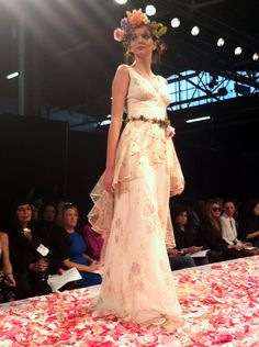 Gorgeousness from Claire Pettibone at Bridal Market: This one has a silk peplum that turns into a train!