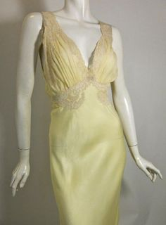 Breathtaking moonglow silk and lace 1940s peignoir set from Marshall Field and Company. Bias cut gown has soft ivory lace beneath bust of silk chiffon, lace straps to deep V back. Half sash ties in back. Robe of silk and lace.