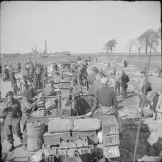 Universal Carriers of 49th (West Riding) Division's Reconnaissance Regiment are welcomed by Dutch civilians on the outskirts of Kampen, 19 April 1945.