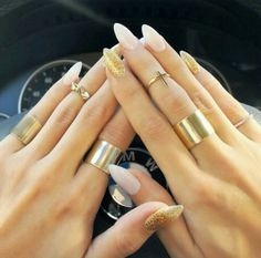 Everything about this is great! Almond shaped nails, nail color, and gold jewelry!