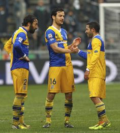 Marco Parolo (C), Mattia Cassani (L) and Walter Gargano (R) of Parma FC celebrate their victory at the end of the Serie A match between US S...