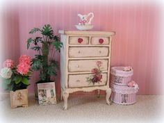 Really lovely tall chest of drawers handpainted in a vintage creamy white  and then distressed to make it look old and shabby.  This has 5 opening