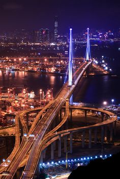 The night scene of Stonecutters Bridge, from Tsing Yi Peak, Hong Kong (by Ali Tse).