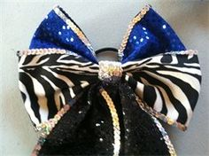 Glitzy cheer bows.  *Anyone know where I can find sequin ribbon?