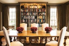 love the dining room filled with books (great Before and After renovation in Nashville)
