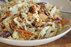 Growing up, my mom regularly made Ichiban salad – a crunchy mix of coleslaw, packaged ramen noodles, toasted almonds and a tangy dressing made with rice vinegar, oil and part of the seasoning… Salad Bar, Side Salad, Soup And Salad, Fruit Salad, Ramen Recipes, Vegetable Recipes, Salad Recipes, Coleslaw Recipes, Recipies