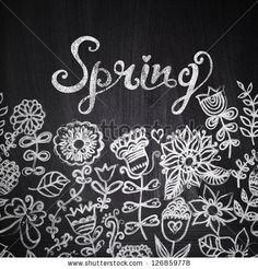 """Chalk flowers on chalkboard blackboard. Floral greeting card with """"Spring"""" lettering. Vintage retro background.You can design cards, notebook cover and so on. Spring theme background. by Markovka, via ShutterStock"""