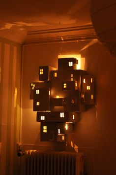 City from cardboard boxes with lights -- use colored lights? Holiday concert decorations?
