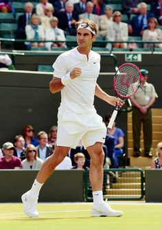 Roger Federer of Switzerland celebrates in his Gentlemens Singles Quarter Final match against Gilles Simon of France during day nine of the Wimbledon Lawn Tennis Championships at the All England Lawn Tennis and Croquet Club on July 8, 2015 in London, England.