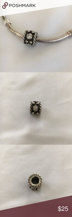 Pandora Oxy Crown Charm Pandora sterling silver with clear cubic zirconia accents on retired charm.  Excellent condition. Pandora Jewelry Bracelets
