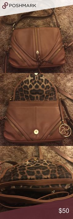 Jessica Simpson Purse This purse holds it all! Used a couple of times took it to Disneyland and other outings and it was great! Does have some color rub off from jeans but not bad! (See Picture) *OBO Jessica Simpson Bags Crossbody Bags