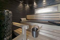 Finnish sauna. Dark and light wood.