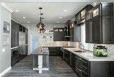 Grey plank tile, dark cabinets, light countertops for kitchen