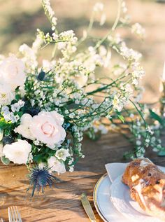 Floral by Color Theory Collective | Photography by Brittany Jean Photography | Dress by Weddington Way | Planning/Design by Olive and Belle | Natural Silk by Seda Medicina | Hair and Makeup by Lola Beauty ATX | Vintage Rentals by Bee Lavish | Wedding centerpiece, sweetheart table, textured, modern, table setting, tablescape, gold flatware, crystal goblets, white, blush, champagne, light blue, powder blue, greenery, organic, natural floral design | Roses, ranunculus, thistle, peonies…