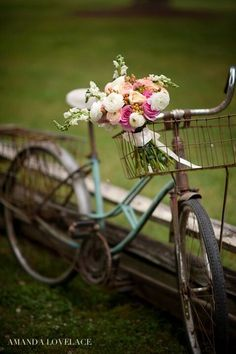 Vintage wedding at Spring Lake Events. Beautiful bridal bouquet and vintage bike  MarliPaige Floral Designs Amanda LoveLace Photography