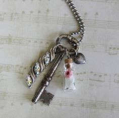 I like the idea of hanging charms, beads off of the vintage key.