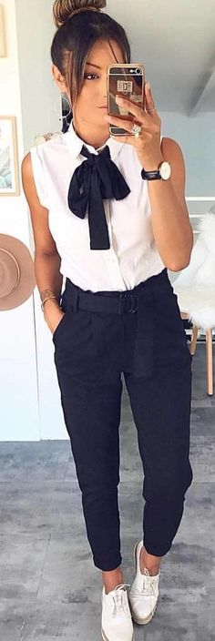 #winter #outfits white and black ribbon-accent sleeveless shirt and black pants. Pic by @milano_streetstyle.