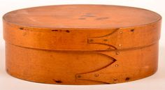 "Conestoga Auctions -  Harry B. Hartman Estate Auction - Session II  May 16, 2015.  Lot 517.     Estimate:	$200 – $400.  Sold: $218.   Description:  Shaker 19th Century Oval Bentwood Band Box. Lapped finger joints with copper tack construction. 3-1/4""h x 9""w x 6-3/8""d. Condition: Very good, minor stains and wear."