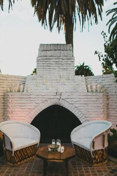 love this rustic outdoor fireplace situation