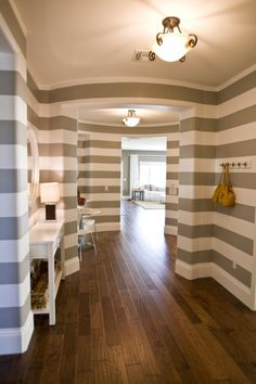 normally this stripe would seem like too much, but I love the taupe and the continuous look through the house