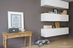 i love this look. a great use of vertical space for storage. The spacing is of importance too so you can use both the closed storage of the cabinet and the top of the cabinet as open display storage.
