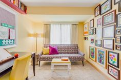Doing homework just got ever so much more fun: This cheery room sets up a desk with a bright yellow chair opposite a rainbow-colored gallery wall filled with framed kid art. At the end of the room, brainstorm in style on the graphic print sofa.