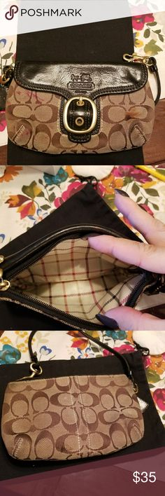 Coach wristlet Gently used there are some stains on the outside of the wristlet but the inside none great little purse to take out on the go coach Bags Clutches & Wristlets