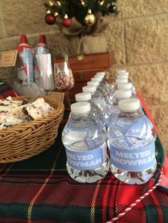 Hot Chocolate Bar at the neighborhood holiday party. Gotta have Melted Snow water bottles!